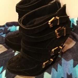 Black and gold wedge shoes